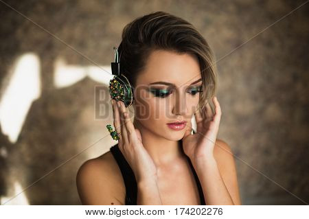 Lovely girl with tanned skin and white hair listening to music on headphones. Female beauty portrait of a beautiful woman listen music. Enjoying good music