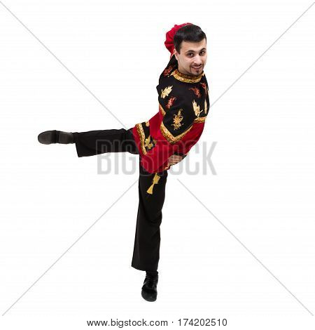 young man wearing a folk russian costume posing against isolated white background
