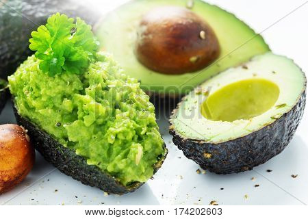 Avocados cut open and filled with Avocado-dip