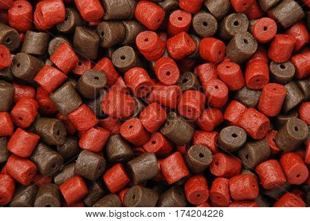 Brown with red pre-drilled halibut pellets for carp fishing background