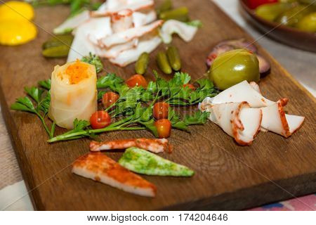 Salo with cucumbers and pepper on a wooden board. Traditional Ukrainian food