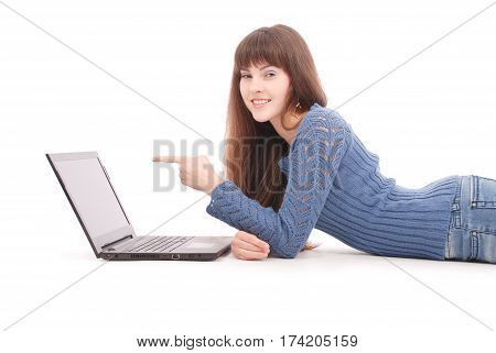 Young woman lying on floor using laptop. Young caucasian woman lying down isolated on white background.