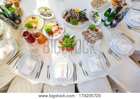 table set service with silverware and glass stemware at restaurant before