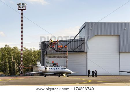 OSTRAVA CZECH REPUBLIC - SEPTEMBER 22: Business jet Cessna Citation Excel 560XL stands in front of airport hangar on September 22 2012 in Ostrava Czech republic. Cessna Citation Sovereign and Latitude get steep approach certification.