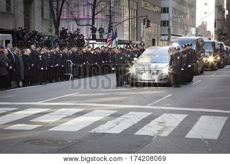 NEW YORK - JAN 13 2017: NYPD Det. Steven McDonald funeral procession and service at St Patricks Cathedral, 5th Avenue, Manhattan - Hearse and funeral procession motorcade leaves St Patricks Cathedral.