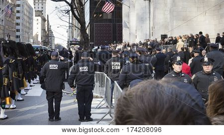 NEW YORK - JAN 13 2017: NYPD Det. Steven McDonald funeral procession and service at St Patricks Cathedral, 5th Ave, Manhattan - Flag-draped coffin carried past hundreds of people from the cathedral.