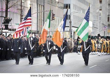 NEW YORK - JAN 13 2017: NYPD Det. Steven McDonald funeral procession and service at St Patricks Cathedral, 5th Avenue, Manhattan - New York City Police Department Emerald Society Color Guard.