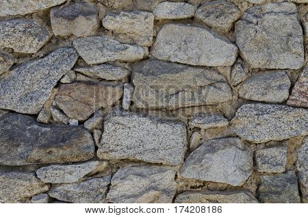 Ancient stone wall texture background with wooden consolidation,  Koprivshtitsa, Bulgaria