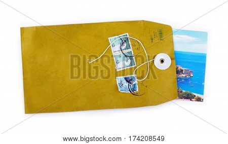 Open paper envelope with sea holiday postcard inside isolated on white background
