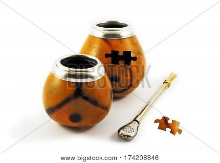 Two yerba mate gourds with missing puzzle element isolated on white