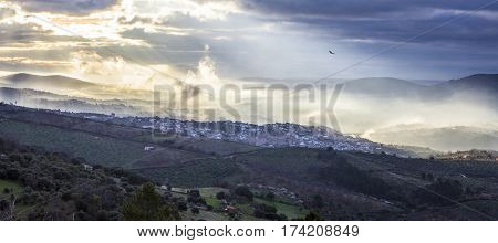 Stunning overview of Guadalupe village during a foggy sunrise Caceres Spain. Panoramic view