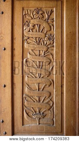 DEIR RAFAT ISRAEL - FEBRUARY 17 2017: Carved wooden panel doors in the church in the monastery of Dir Rafat with the inscription Ave Maria in different languages