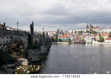 PRAGUE, CZECH REPUBLIK - OCTOBER 21, 2016: Charles Bridge in Prague with a view of the Lesser Town and the Castle District. The Charles Bridge is one of the main attractions of the city