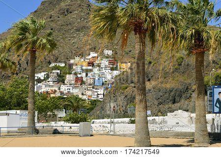 Playa De Las Teresitas beach Tenerife Canary Islands Spain Europe - June 14 2016: Playa De Las Teresitas apartments built on the side of a mountain