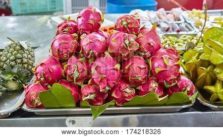 an exotic tropical fruit at the market pitahaya fruits drakon-frukt