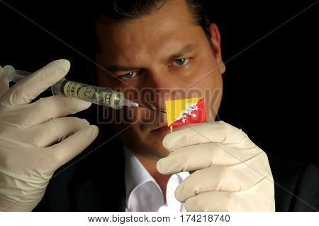 Young Businessman Gives A Financial Injection To Bhutanese Flag Isolated On Black Background