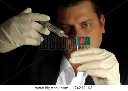 Young Businessman Gives A Financial Injection To Bangladeshi Flag Isolated On Black Background