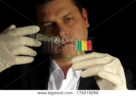 Young Businessman Gives A Financial Injection To Malian Flag Isolated On Black Background