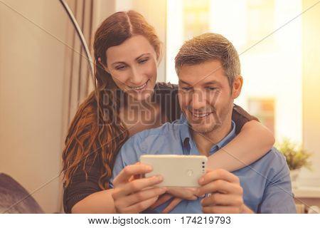 couple watching in smartphone online stream content
