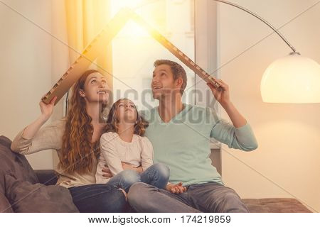 family in house planning with daughter