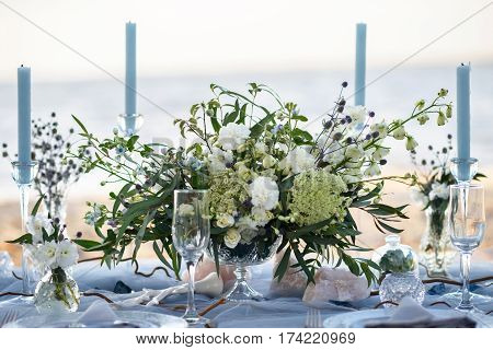 accessories at the wedding table. Close-up. accessories at the wedding table on the beach. accessories at the wedding table at sunset.