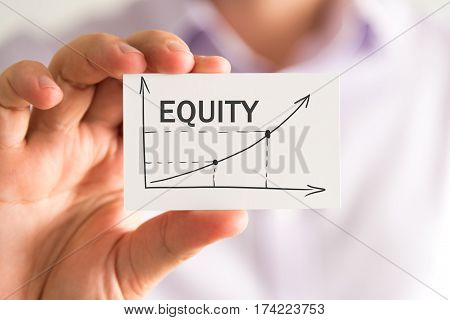 Businessman Holding A Card With Equity Rising Arrow And Chart