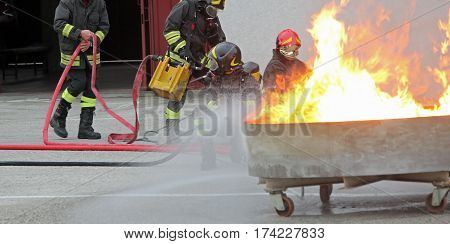 Fire Fighters During The Exercise In The Firehouse To Extinguish