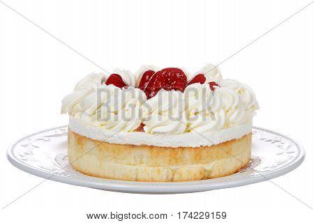 Porcelain plate with large strawberry shortcake dessert isolated on white background