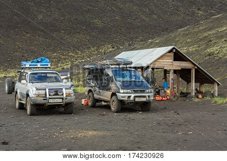 Kamchatka Peninsula, Russia - August 20, 2016: Cars SUVs in the parking lot for tourists. North Breakthrough Great Tolbachik Fissure Eruption 1975