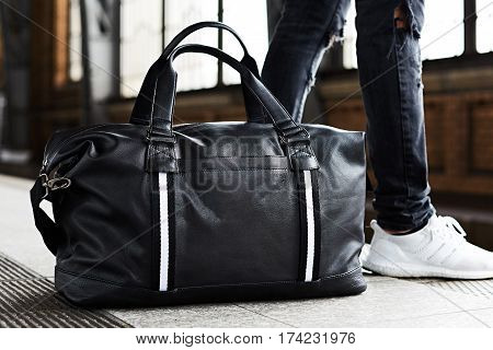 Male tourists are carrying luggage waiting train on the platform. Photo light and adjustable tone vintage..