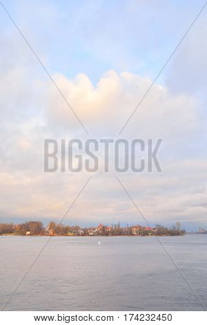 View of Neva River on the outskirts of St. Petersburg at cloud spring evening Russia.