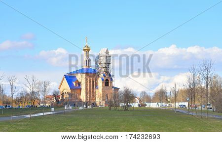 Park in Rybatskoe and The Church at early spring in St.Petersburg Russia.