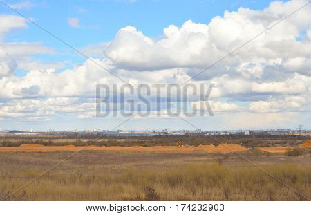 View to the side of St. Petersburg with Pulkovo heights at spring day on the outskirts of St. Petersburg Russia.