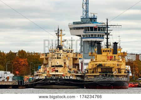 Yellow icebreakers moored at the port of Riga Europe