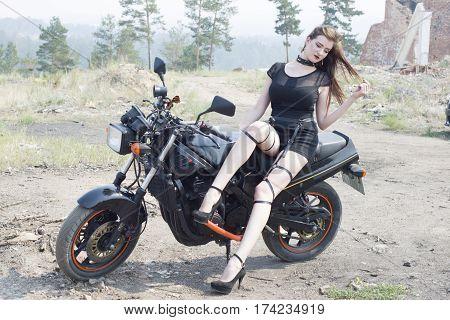 Beautiful Slender Girl And A Sport Bike.