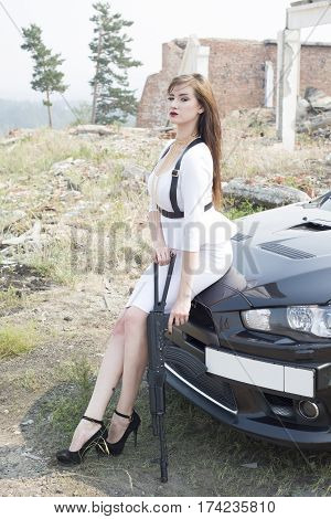 Beautiful Girl Bodyguard Next To A Sports Car.