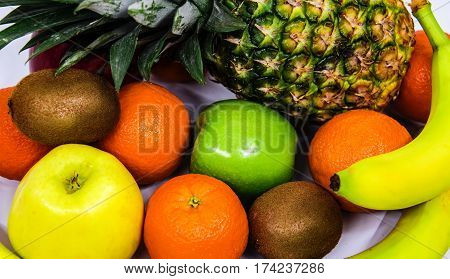 fruits fresh raw full of freshness and it is very healthy, Fresh fruits. Healthy food. Mixed fruits and nuts background. Healthy eating, dieting, love fruits. Studio photography of different fruits and nuts on old wooden table. Organic Healthy Assorted Fr