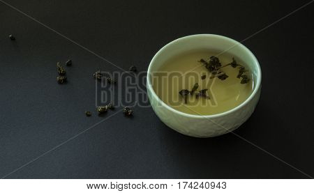 Japanese tea cup oolong on black background. Tea time.