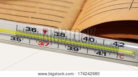 Mercury thermometer and medical card flu or colds