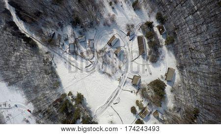 Traditional Ukrainian village in winter, aerial view