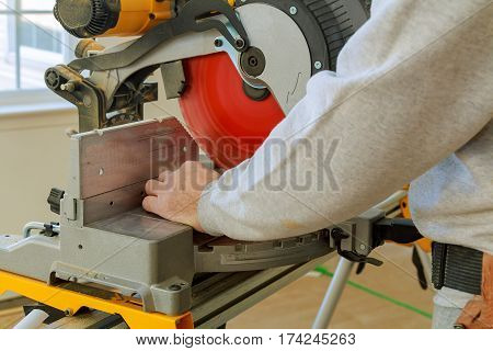 Man, worker sawing wood with a circular saw, machine for wood cutting. The manufacture of furniture. Furniture accessories. Machine for cutting MDF, particle Board.
