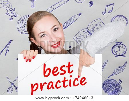 Young woman holding whiteboard with writing word: best practice. Technology, internet, business and marketing