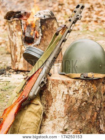 Soviet soldier's helmet near the submachine gun Shpagin