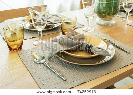 Empty Plate With Service Ware On Wooden Table