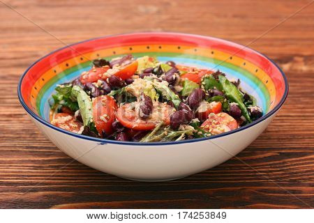 Tuna salad with beans and cherry tomatoes. Low calories heathy eating concept.