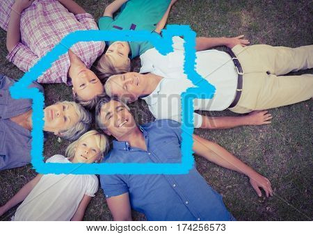 Digital composition of family lying on grass overlaid with house shape