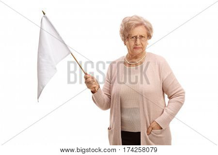 Disappointed mature woman holding a white flag isolated on white background