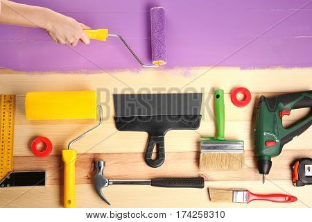 Decorator tools and hand painting wooden surface