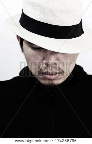 handsome mysterious man with hat on white