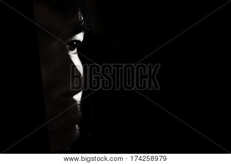 Depressed And Hopeless Man Alone In The Dark, Light On Face